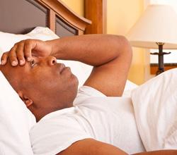 sleepless man restless in bed